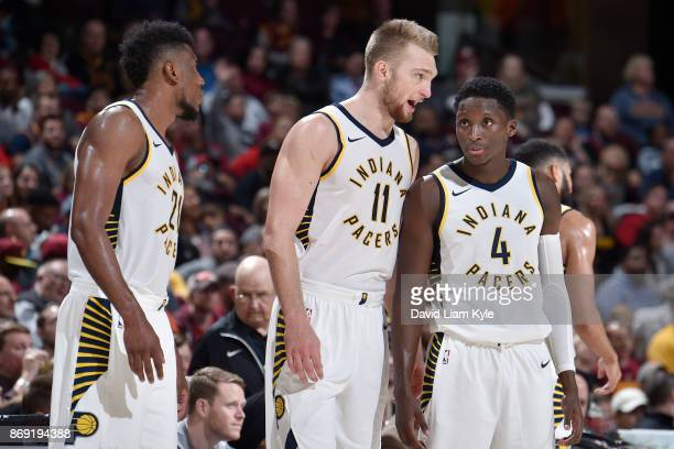 Domantas Sabonis of the Indiana Pacers speaks with Victor Oladipo of the Indiana Pacers during the game against the Cleveland Cavaliers on November 1...