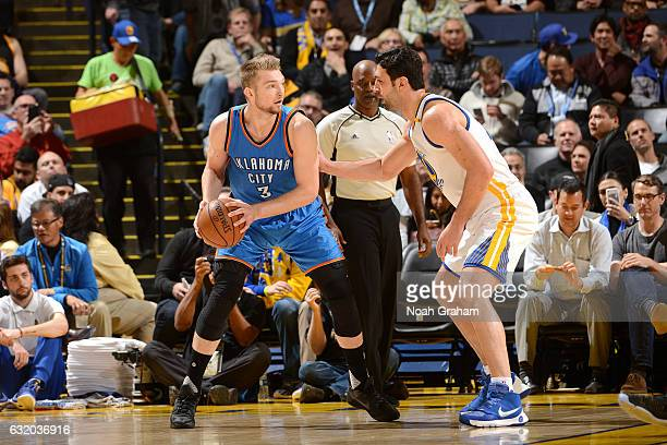 Domantas Sabonis of the Oklahoma City Thunder handles the ball during the game against the Golden State Warriors on January 18 2017 at ORACLE Arena...