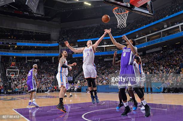 Domantas Sabonis of the Oklahoma City Thunder rebounds against Rudy Gay of the Sacramento Kings on November 23 2016 at Golden 1 Center in Sacramento...