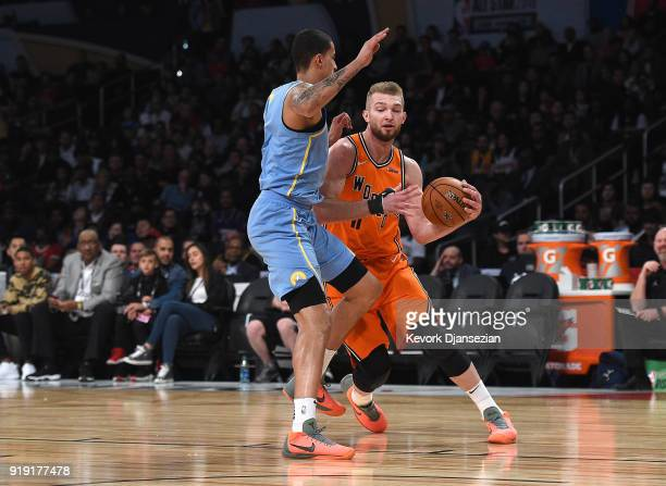 Domantas Sabonis of the World Team drives on Kyle Kuzma of Team USA during the 2018 Mountain Dew Kickstart Rising Stars Game at Staples Center on...