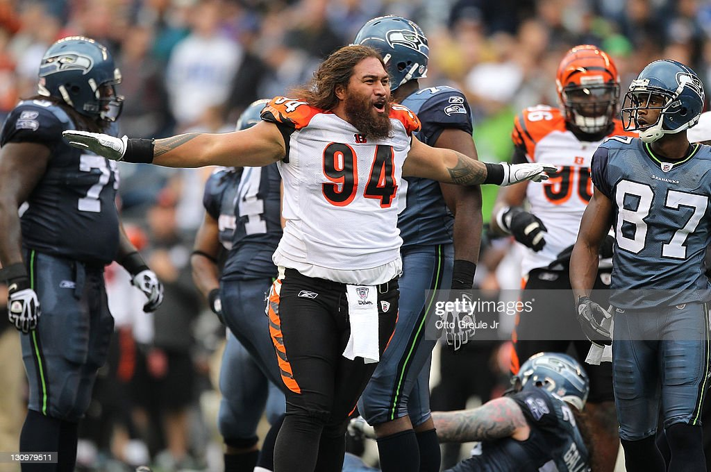 Domata Peko #94 of the Cincinnati Bengals reacts after losing his helmet while tackling Marshawn Lynch #24 of the Seattle Seahawks at CenturyLink Field on October 30, 2011 in Seattle, Washington. The Bengals defeated the Seahawks 34-12.