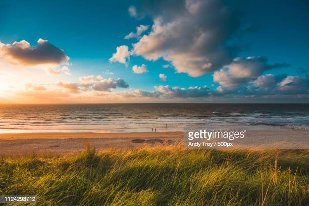 domburg beach - zonsondergang stock pictures, royalty-free photos & images