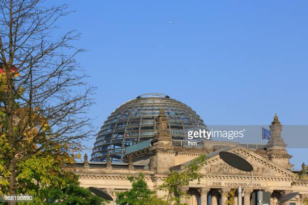 Dome and famous inscription on the architrave on the west portal of the Reichstag building in Berlin: 'Dem Deutschen Volke' (Germany)
