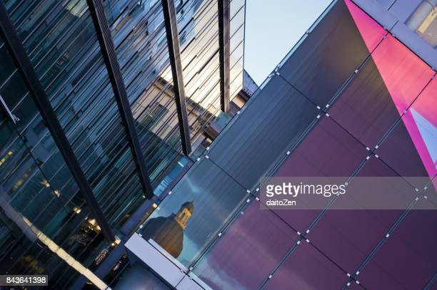 Dome of Bavarian State Chancellery (Bayerische Staatskanzlei) reflected in glass front of modern office building, Munich, Bavaria, Germany
