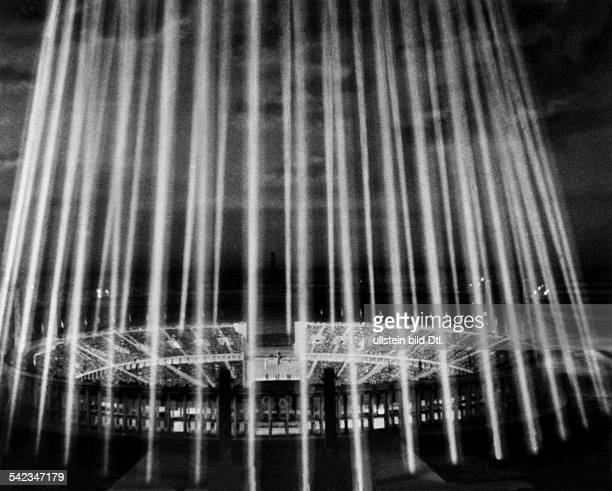 Dome of light above the Olympiastadion during the closing ceremony of the 1936 Summer Olympics in Berlin August 16 1936 Scene taken from Leni...