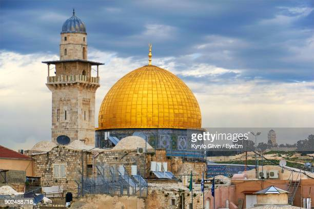 dome of the rock in city against sky - dome of the rock stock pictures, royalty-free photos & images