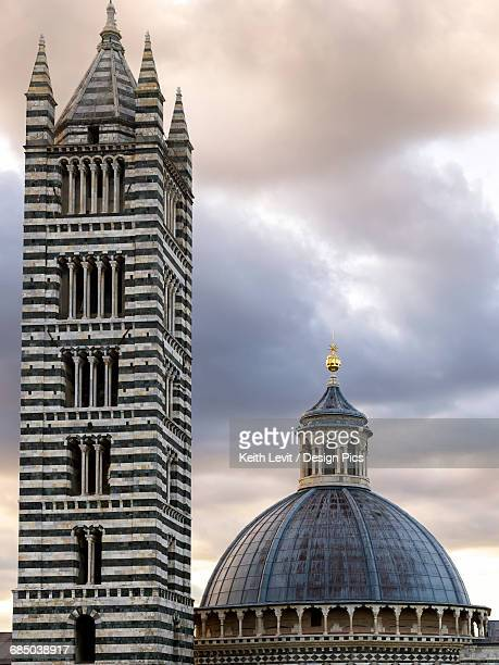 Dome roof and striped tower of Siena Cathedral