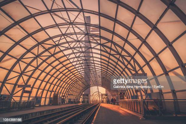 dome roof over railroad station platform - bucharest stock pictures, royalty-free photos & images