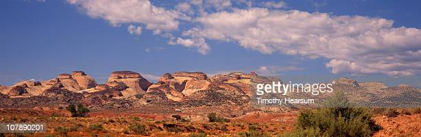 dome shaped rock formations with clouds beyond - timothy hearsum stock pictures, royalty-free photos & images