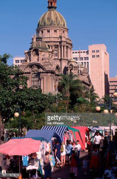 domed city hall and stalls at a durban open air market - ダーバン ストックフォトと画像
