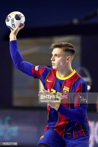 Domen Makuc of FC Barcelona passes the ball during the VELUX EHF Champions League FINAL4 semi-final between FC Barcelona v HBC Nantes at Lanxess...