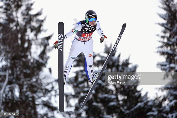 Domen Prevc of Slovenia competes at the trail round on Day 2 of the 65th Four Hills Tournament ski jumping event at PaulAusserleitnerSchanze on...