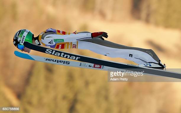 Domen Prevc of Slovenia soars through the air during his first competition jump on Day 2 of the 65th Four Hills Tournament ski jumping event on...