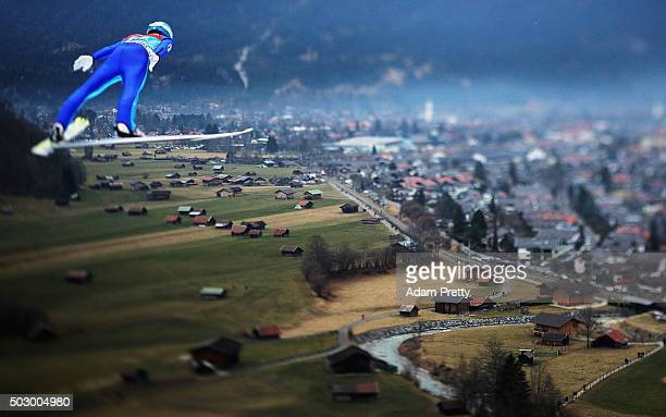 Domen Prevc of Slovenia soars through the air during his qualification jump on Day 1 of the 64th Four Hills tounament on December 31 2015 in...