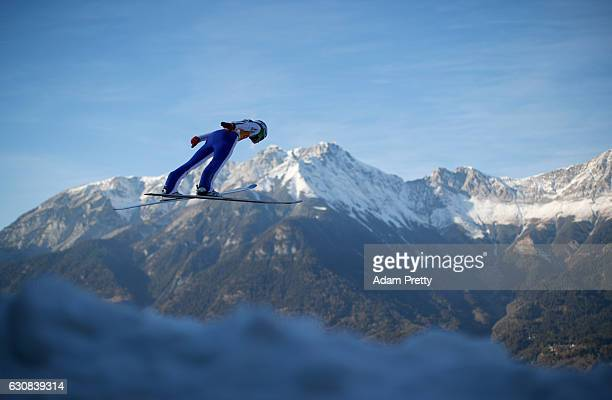 Domen Prevc of Slovenia soars through the air during his qualification jump on Day 1 of the 65th Four Hills Tournament ski jumping event on January 3...