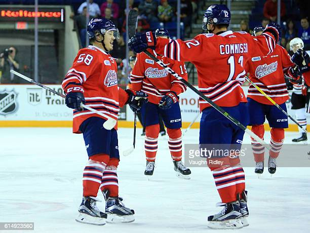 Domenic Commisso of the Oshawa Generals celebrates a goal with Mitchell Vande Sompel during the second period of an OHL game against the Niagara...