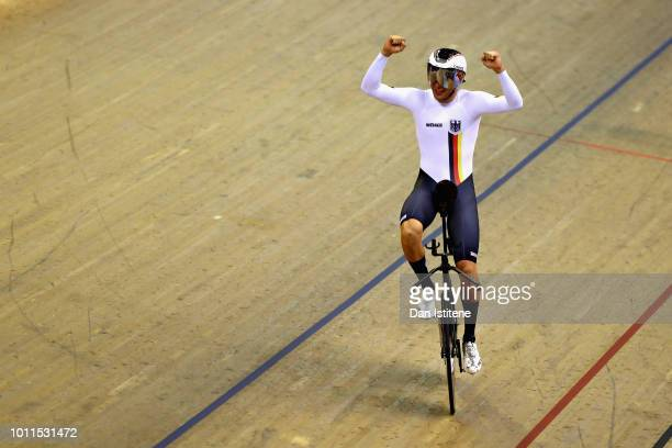 Domenic Weinstein of Germany celebrates winning gold in the final of the Men's 4000m Individual Pursuit during the track cycling on Day Four of the...