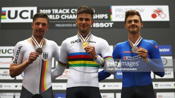 Domenic Weinstein of Germany Filippo Ganna of Italy and Davide Plebani of Italy celebrate on the podium for the Men's individual pursuit on day three...