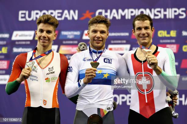 Domenic Weinstein of Germany Ivo Oliveira of Portugal and Claudio Imhof of Switzerland are presented with their medals for the Men's 4000m Individual...