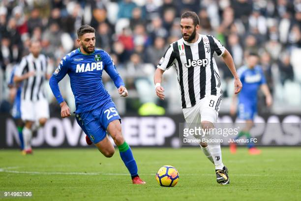 Domenico Berardi and Gonzalo Higuain during the serie A match between Juventus and US Sassuolo at Allianz Stadium on February 4 2018 in Turin Italy