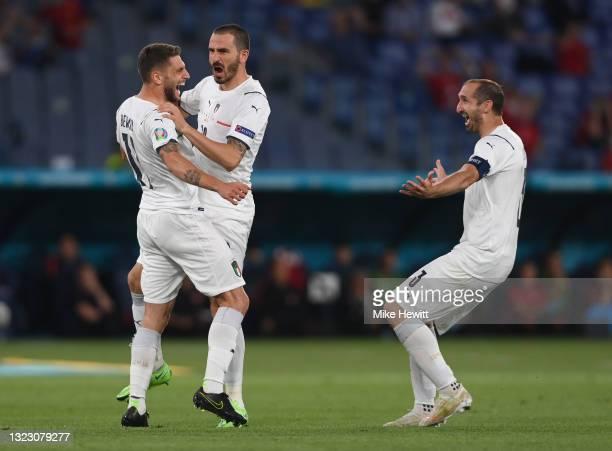 Domenico Berardi, Leonardo Bonucci and Giorgio Chiellini of Italy celebrate their side's first goal, an own goal scored by Merih Demiral of Turkey...