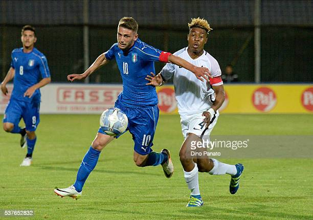 Domenico Berardi nof Italy U21 competes with Presnel Kompebe of France U21 during the International Friendly match between Italy U21 and France U21...