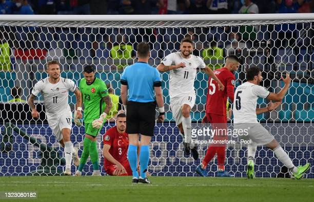 Domenico Berardi of Italy celebrates after their side's first goal, an own goal scored by Merih Demiral of Turkey during the UEFA Euro 2020...