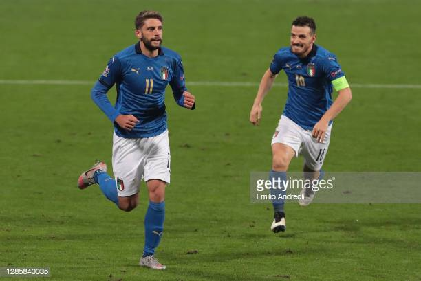 Domenico Berardi of Italy celebrates his goal with his team-mate Alessandro Florenzi during the UEFA Nations League group stage match between Italy...