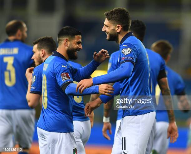 Domenico Berardi of Italy celebrates with teammate Lorenzo Insigne after scoring the opening goal during the FIFA World Cup 2022 Qatar qualifying...