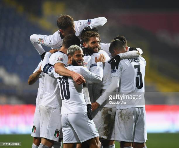 Domenico Berardi of Italy celebrates with team-mates after scoring the second goal during the UEFA Nations League group stage match between...
