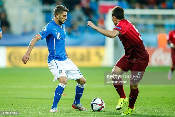 Domenico Berardi of Italy competes for the ball with Raphael Guerreiro of Portugal during the UEFA Under21 European Championship 2015 match between...