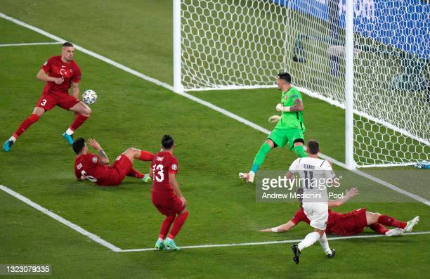 Domenico Berardi of Italy crosses the ball in incident leading to Merih Demiral of Turkey scoring an own goal for Italy's first goal during the UEFA...