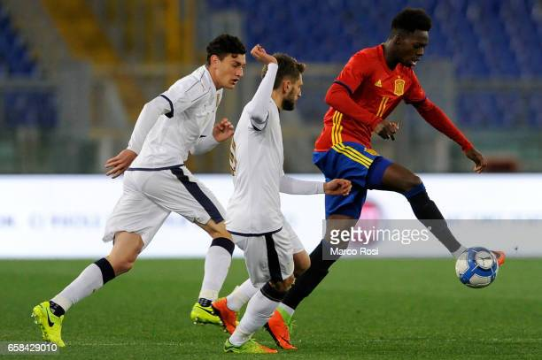 Domenico Berardi of Italy U21 compete for the ball with Inaki Williams of Spain U21 during the international friendly match between Italy U21 and...