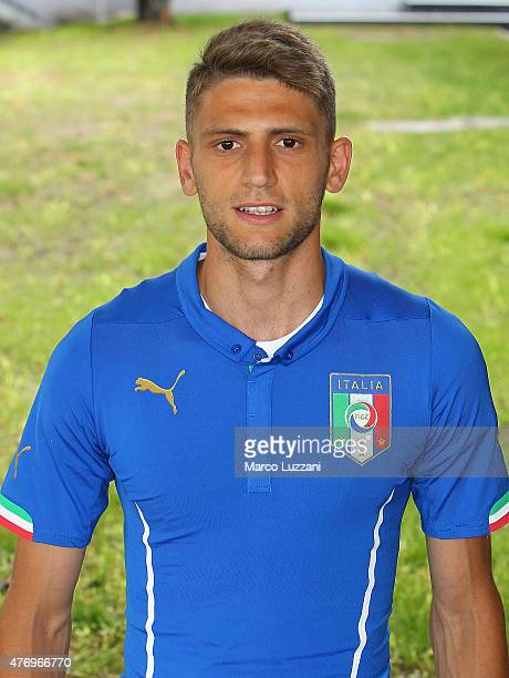 Domenico Berardi of Italy U21 poses with the shirt during the official Italy U21 portrait session at the training ground on June 13 2015 in Appiano...