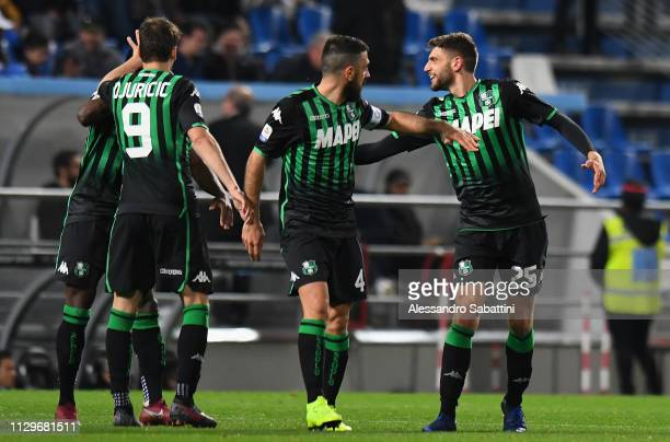 Domenico Berardi of Sassuolo celebrates after scoring the opening goal with team mates during the Serie A match between US Sassuolo and SSC Napoli at...