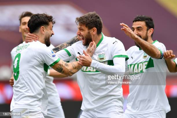 Domenico Berardi of Sassuolo celebrates with Francesco Caputo after scoring his sides first goal during the Serie A match between Torino FC and US...