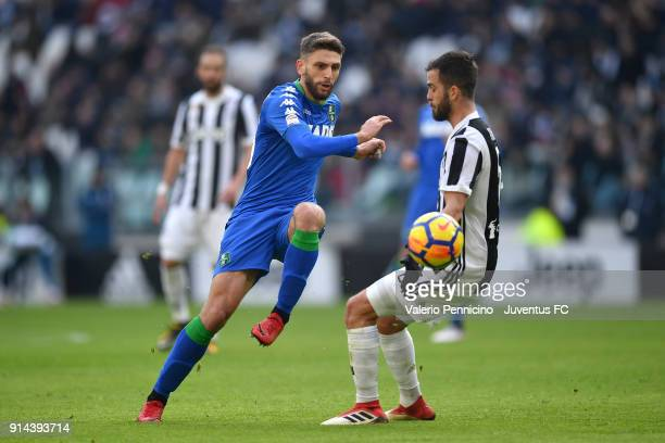 Domenico Berardi of Sassuolo competes for the ball with Miralem Pjanic of Juventus during the serie A match between Juventus and US Sassuolo on...