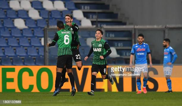 Domenico Berardi of U.S. Sassuolo Calcio celebrates with Rogerio after scoring their side's first goal during the Serie A match between US Sassuolo...
