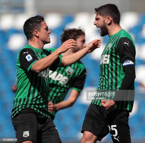 Domenico Berardi of U.S. Sassuolo Calcio celebrates with team mate Giacomo Raspadori after scoring their side's first goal from the penalty spot...