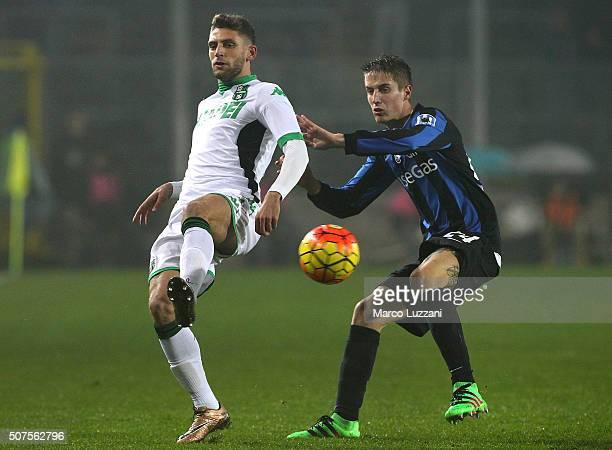 Domenico Berardi of US Sassuolo Calcio competes for the ball with Andrea Conti of Atalanta BC during the Serie A match between Atalanta BC and US...
