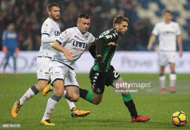 Domenico Berardi of US Sassuolo Calcio competes for the ball with Bruno Martella of FC Crotone during the Serie A match between US Sassuolo and FC...