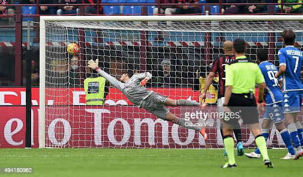 Domenico Berardi of US Sassuolo Calcio scores the first goal during the Serie A match between AC Milan and US Sassuolo Calcio at Stadio Giuseppe...