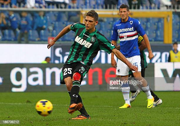 Domenico Berardi of US Sassuolo Calcio scores their fourth goal from the penalty spot to complete his hat-trick during the Serie A match between UC...
