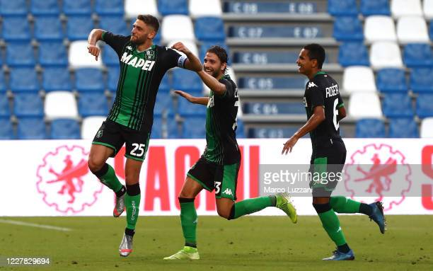 Domenico Berardi of US Sassuolo celebrates after scoring the second goal of his team with team-mate Manuel Locatelli during the Serie A match between...