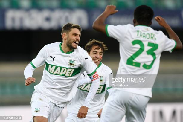 Domenico Berardi of US Sassuolo celebrates after scoring their sides second goal with Maxime Lopez of US Sassuolo and Hamed Junior Traore of US...