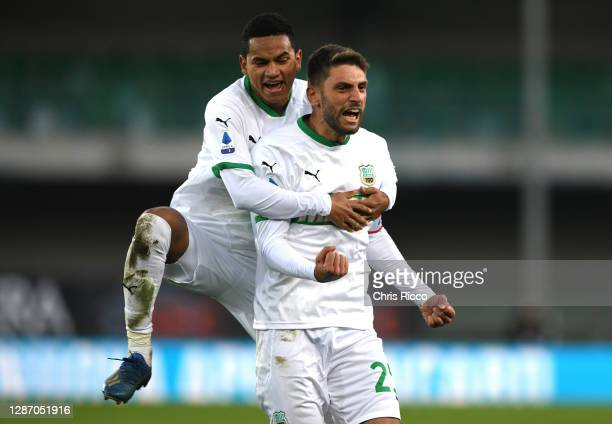Domenico Berardi of US Sassuolo celebrates after scoring their sides second goal with Rogerio of US Sassuolo during the Serie A match between Hellas...