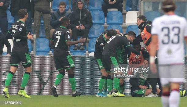 Domenico Berardi of US Sassuolo celebrates with his teammates after scoring the opening goal during the Serie A match between US Sassuolo and...
