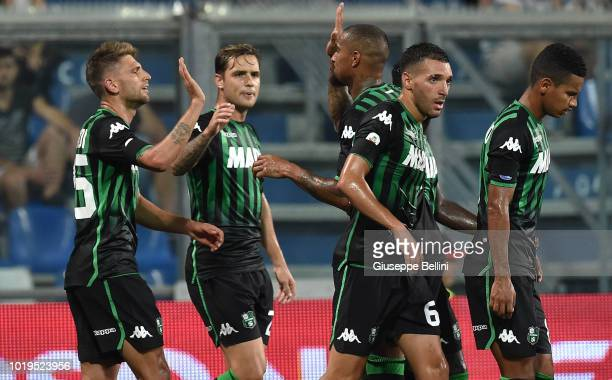 Domenico Berardi of US Sassuolo celebrates with teammates after scoring the opening goal during the Serie A match between US Sassuolo and FC...