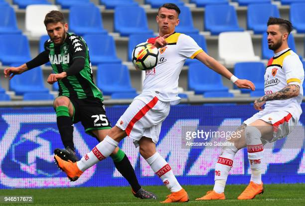 Domenico Berardi of US Sassuolo competes for the ball whit Gaetano Letizia of Benevento Calcio during the serie A match between US Sassuolo and...