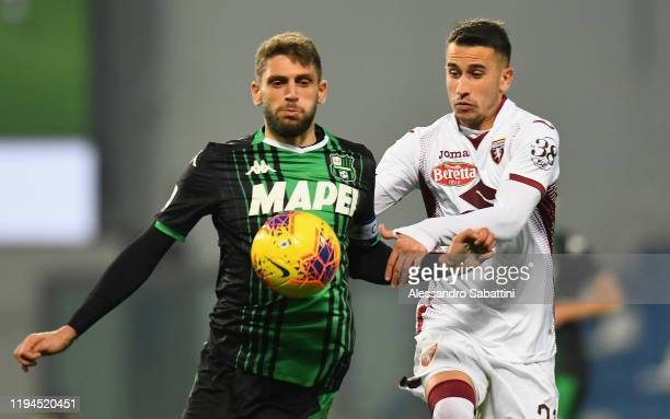 Domenico Berardi of US Sassuolo competes for the ball with Alejandro Berenguer of Torino FC during the Serie A match between US Sassuolo and Torino...
